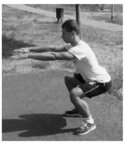 squat a corpo libero mal di schiena
